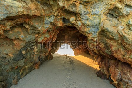 Sunbeams through Natural Arch. Stock photo © yhelfman