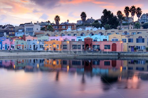 Falu naplemente tükröződések mikulás tengerpart épület Stock fotó © yhelfman