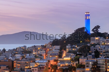 Coit Tower on Telegraph Hill with San Francisco Bay and Angel Island in the background at dusk. Stock photo © yhelfman
