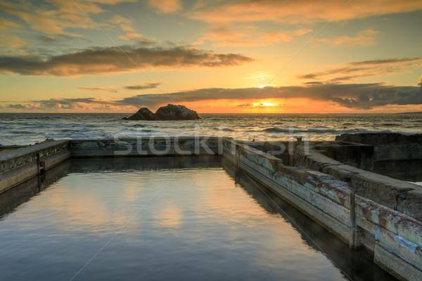Naplemente romok nagy nyilvános sósvízi úszómedence Stock fotó © yhelfman