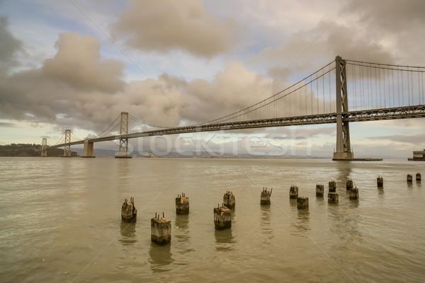 Híd késő délután felhők építészet horizont Stock fotó © yhelfman