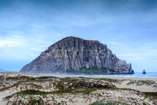 Morro Rock with Sandy Dunes of Morro Creek Beach. Stock photo © yhelfman