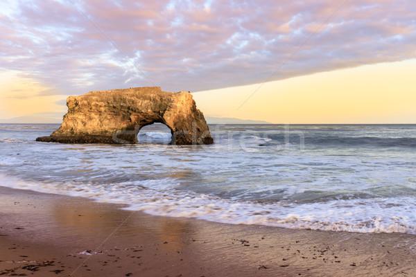 Foto stock: Puesta · de · sol · último · naturales · arco · puentes · playa