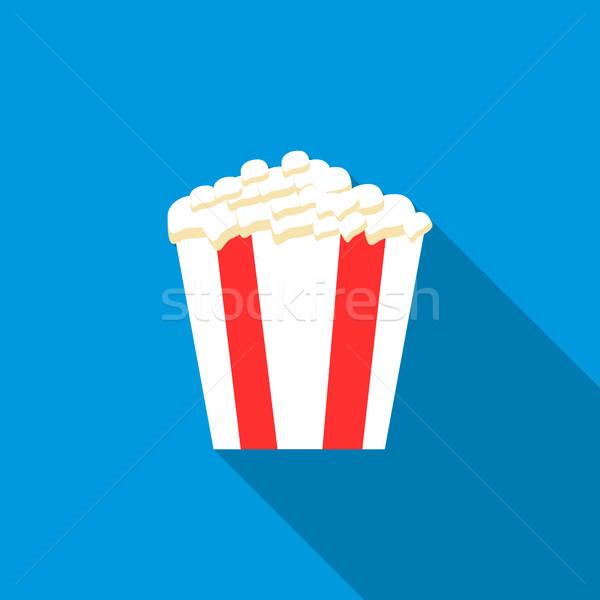 Popcorn in striped bucket icon, flat style Stock photo © ylivdesign
