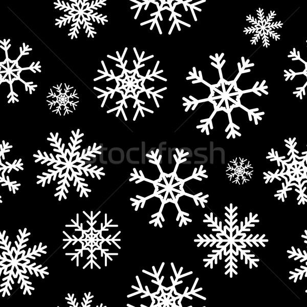 White snowflakes on black background Stock photo © ylivdesign