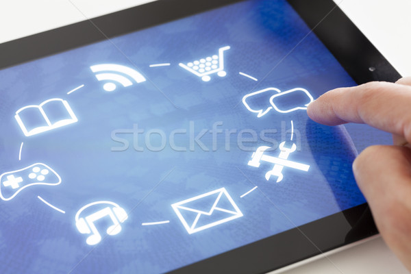 Clicking on a tablet with touchscreen interface Stock photo © ymgerman