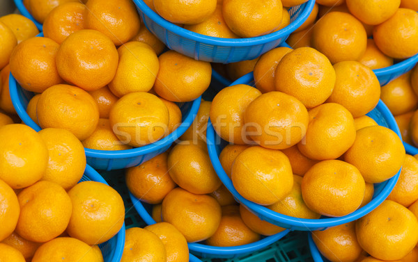 Oranges in baskets for sale in a food market Stock photo © ymgerman
