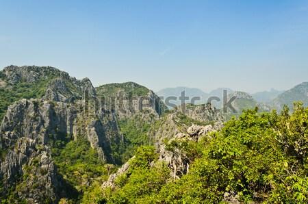 Kilátás felső kő hegy roi égbolt Stock fotó © Yongkiet
