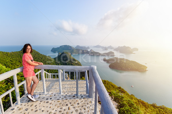 Woman tourist on peak viewpoint of island Stock photo © Yongkiet