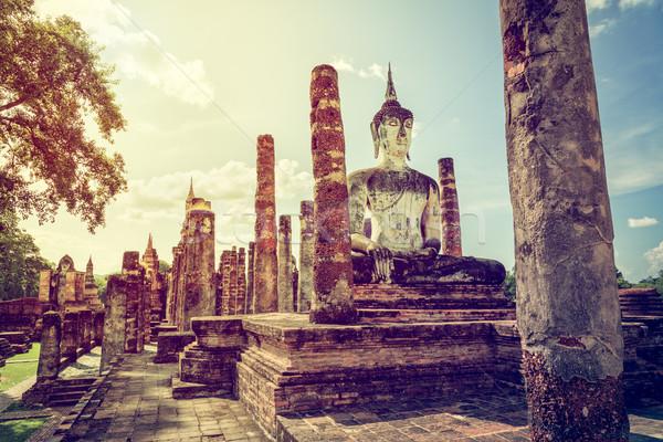 Vintage buddha statue among the ruins Stock photo © Yongkiet