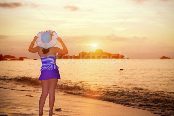 Visitors woman looking the sunrise over the sea Stock photo © Yongkiet