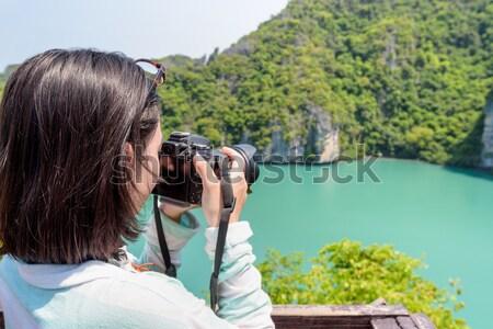 Woman tourist on high scenic view Stock photo © Yongkiet