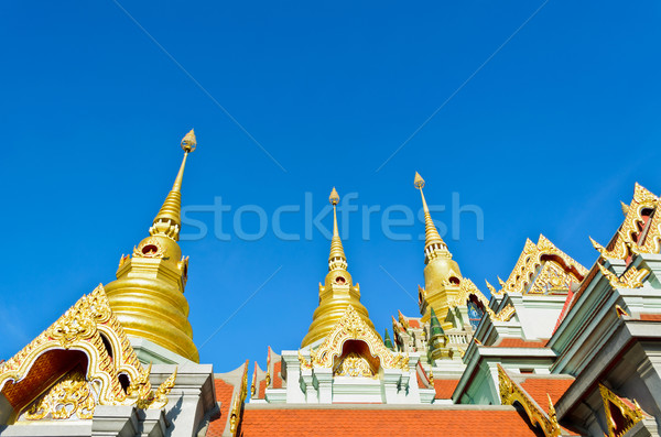 Golden pinnacle of thai temple Stock photo © Yongkiet