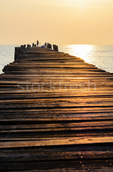 Old wooden pier at sunrise Stock photo © Yongkiet