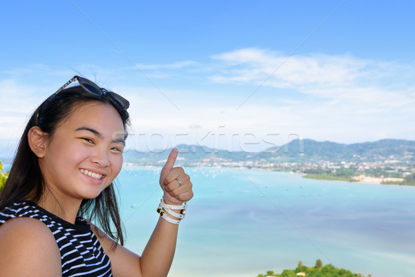 Woman tourist lifting thumb praise beautiful of sea in Phuket, T Stock photo © Yongkiet