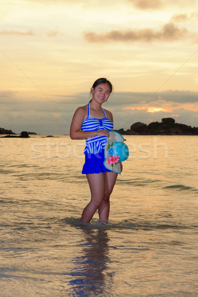 Girl on the beach at sunrise over the sea Stock photo © Yongkiet