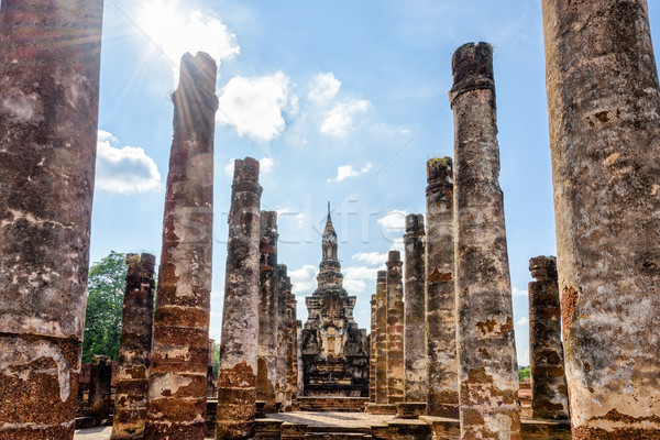 Ancient pagoda among the ruins pillars Stock photo © Yongkiet