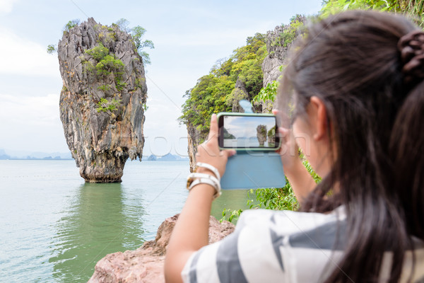 Female traveler shooting natural view by mobile phone Stock photo © Yongkiet