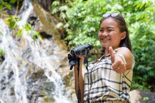 Girl using binoculars in forest Stock photo © Yongkiet
