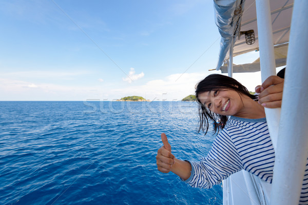 Tourist woman traveling by boat Stock photo © Yongkiet