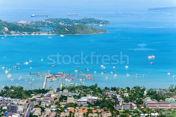 Magasról fotózva kilátás móló turné város tenger Stock fotó © Yongkiet