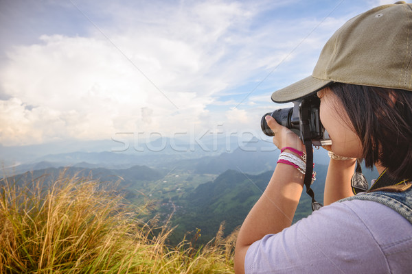 Hiker teens girl taking photo Stock photo © Yongkiet