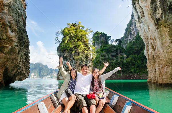 Happy family travel boat ( Guilin of Thailand ) Stock photo © Yongkiet