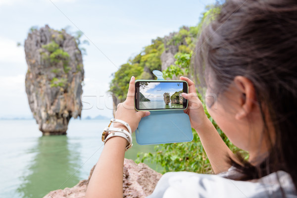 Women tourist shooting natural view by mobile phone Stock photo © Yongkiet