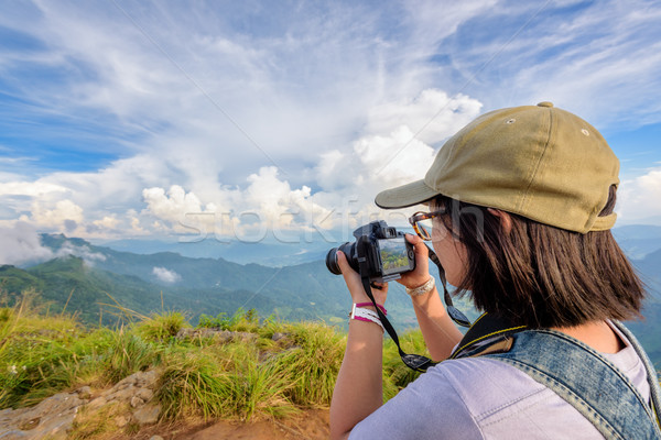 Hiker teens girl taking picture Stock photo © Yongkiet