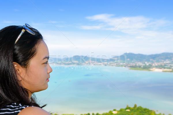 Women tourist looking the sea in Phuket, Thailand Stock photo © Yongkiet