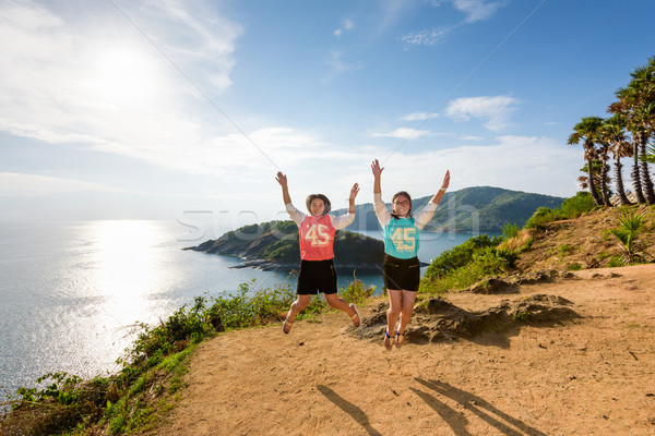 Two girls mother and daughter jumping Stock photo © Yongkiet