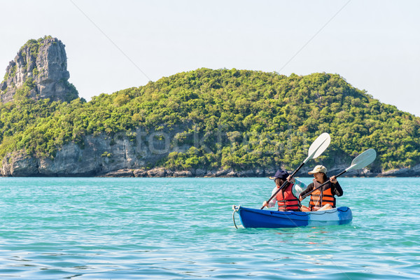 Mother and daughter travel by kayak Stock photo © Yongkiet