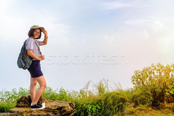 Tourist teen girl poses on mountain Stock photo © Yongkiet