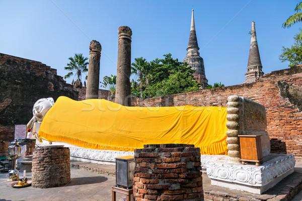 Buda heykel uyku beyaz kapalı sarı Stok fotoğraf © Yongkiet