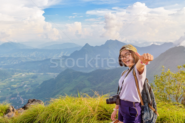 Hiker girl with happy on Phu Chi Fa Mountain Stock photo © Yongkiet