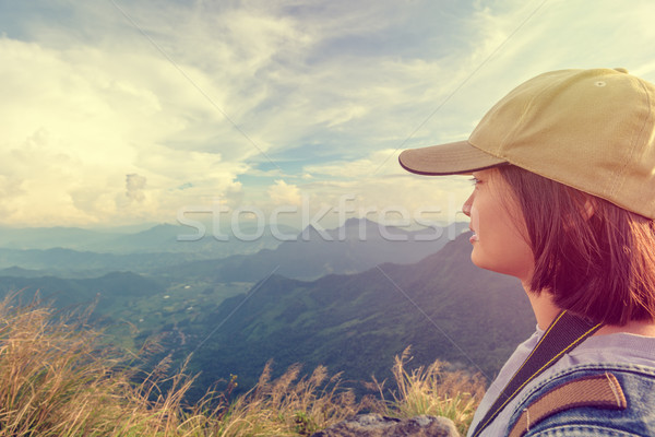 Vintage girl tourist scenic mountains Stock photo © Yongkiet