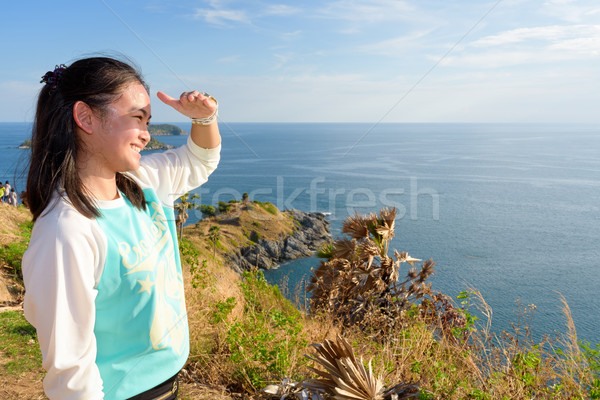 Women tourists looking at beautiful nature sea Stock photo © Yongkiet
