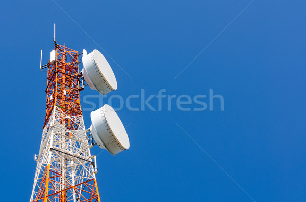 Telecommunication tower on blue sky background Stock photo © Yongkiet