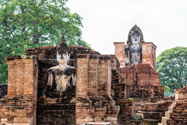 Antigo buda estátua ruínas brilhante sol Foto stock © Yongkiet