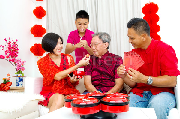 Asiático família três gerações celebrar ano novo chinês Foto stock © yongtick