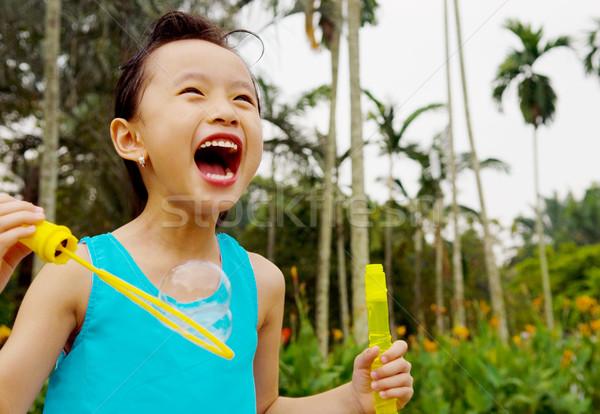 Asiático criança menina ao ar livre criança Foto stock © yongtick