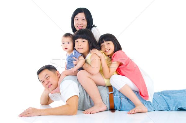 Asian famiglia piggyback divertimento madre padre Foto d'archivio © yongtick