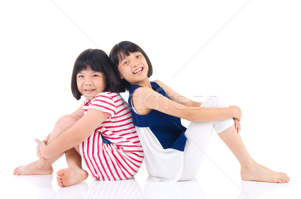 Asian ragazzi sorelle seduta piano ragazza Foto d'archivio © yongtick