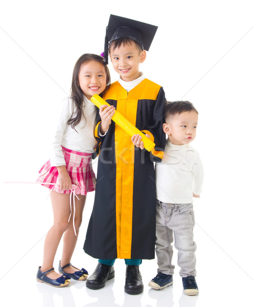Asian kinderen afgestudeerde afstuderen toga Stockfoto © yongtick