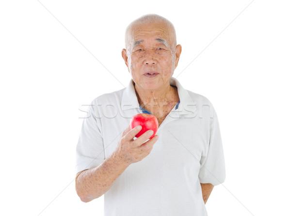 Asian senior uomo vecchio mela Foto d'archivio © yongtick
