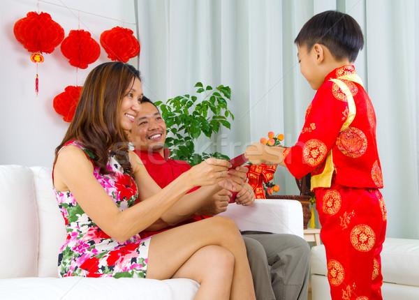 ストックフォト: アジア · 家族 · 男の子 · 赤 · 両親 · 旧正月