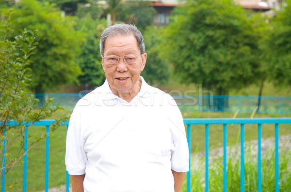 Asiático senior homem retrato sorridente ao ar livre Foto stock © yongtick