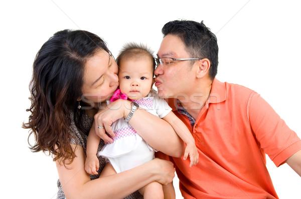 Asiático família pai ou mãe beijando menina cara Foto stock © yongtick