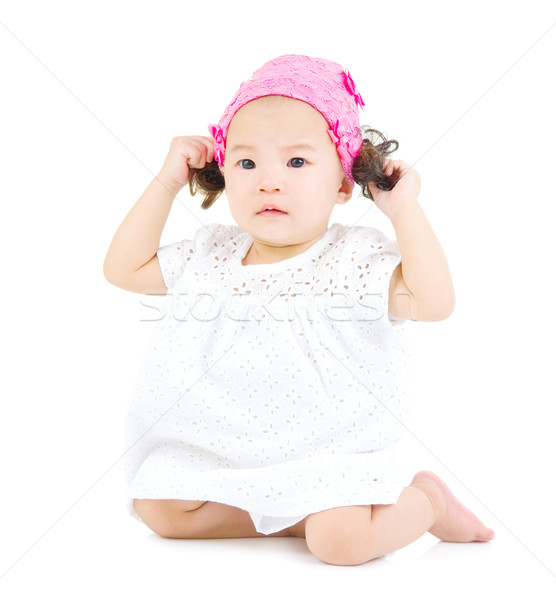 Asian baby cute seduta piano ragazza Foto d'archivio © yongtick