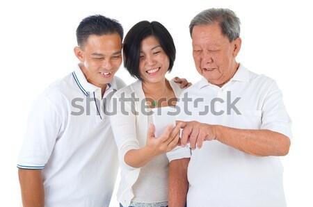 Asiático família moderno tecnologia idade pessoas Foto stock © yongtick
